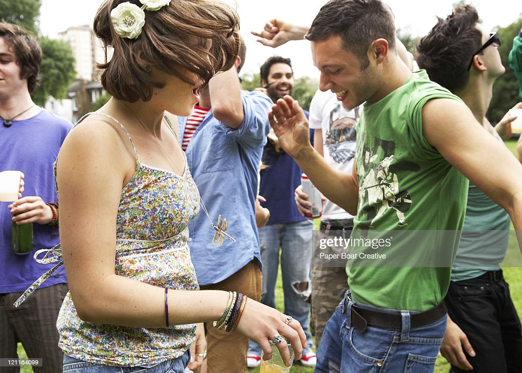 friends dancing in a festival in the park : Stock Photo