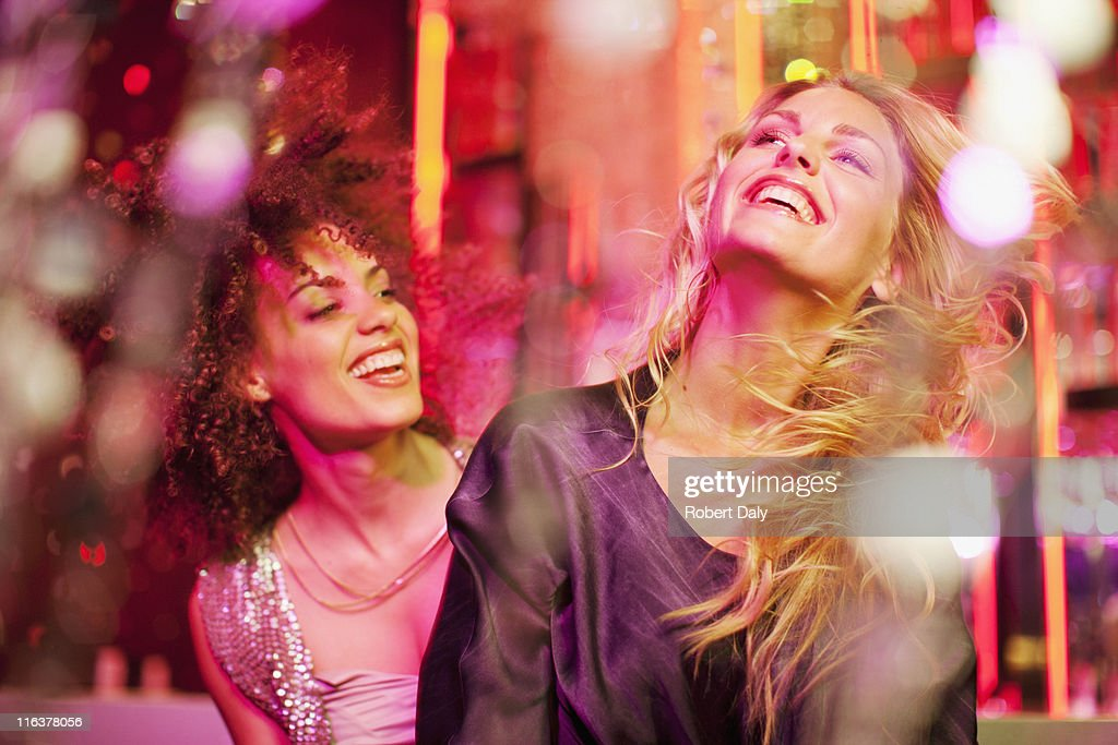 Friends dancing in nightclub : Stock Photo