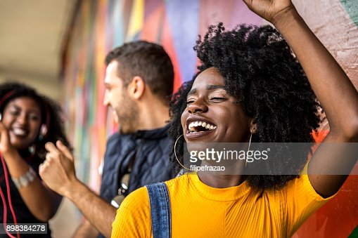 Friends dancing in the park : Stock Photo