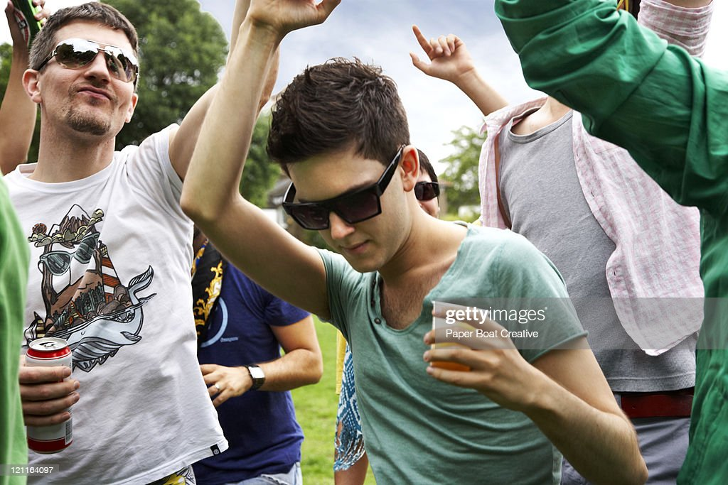 friends dancing to music outdoors in a park : Stock Photo