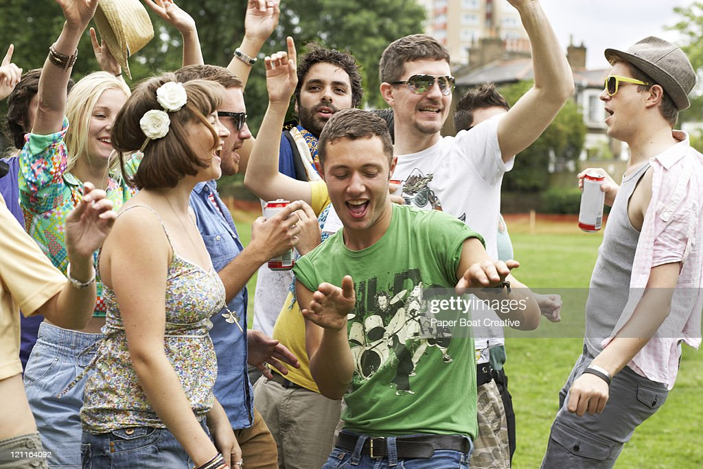 Friends dancing together in the park : Stock Photo