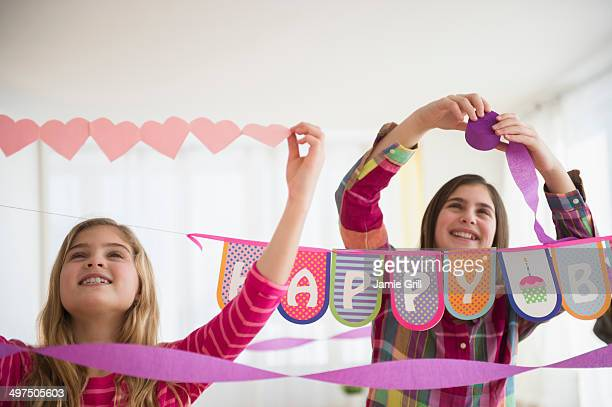 Friends decorating for a party