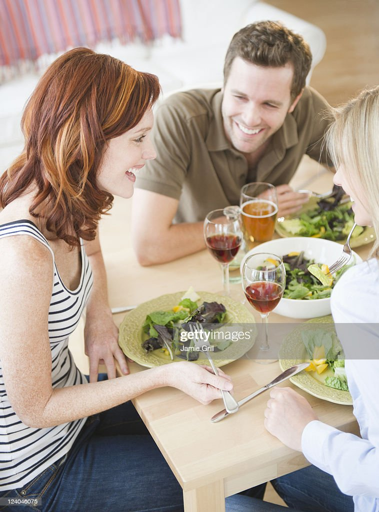 Friends dining together : Stock Photo