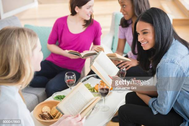 Friends discussing books together