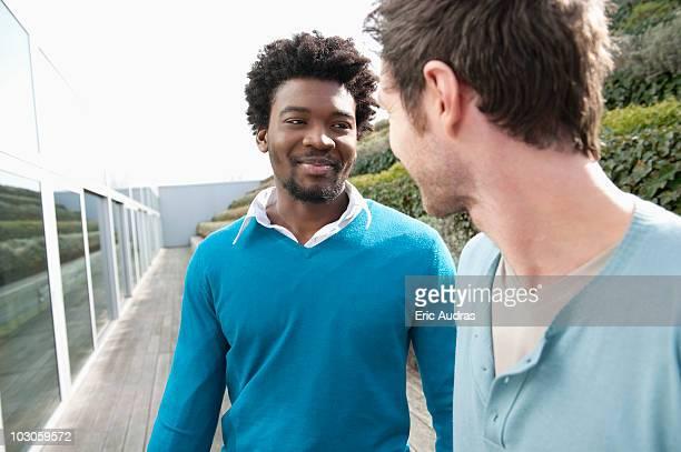 Friends discussing on a boardwalk