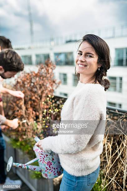 friends doing gardening on the rooftop terrace