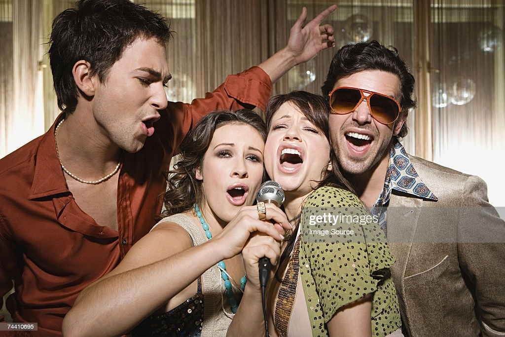 Friends doing karaoke : Stock Photo