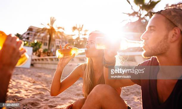 Friends Drinking Beer On The Beach