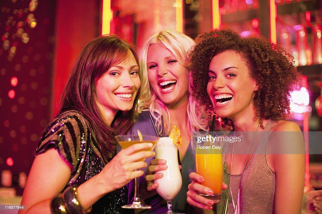 Friends drinking cocktail in nightclub : Stock Photo