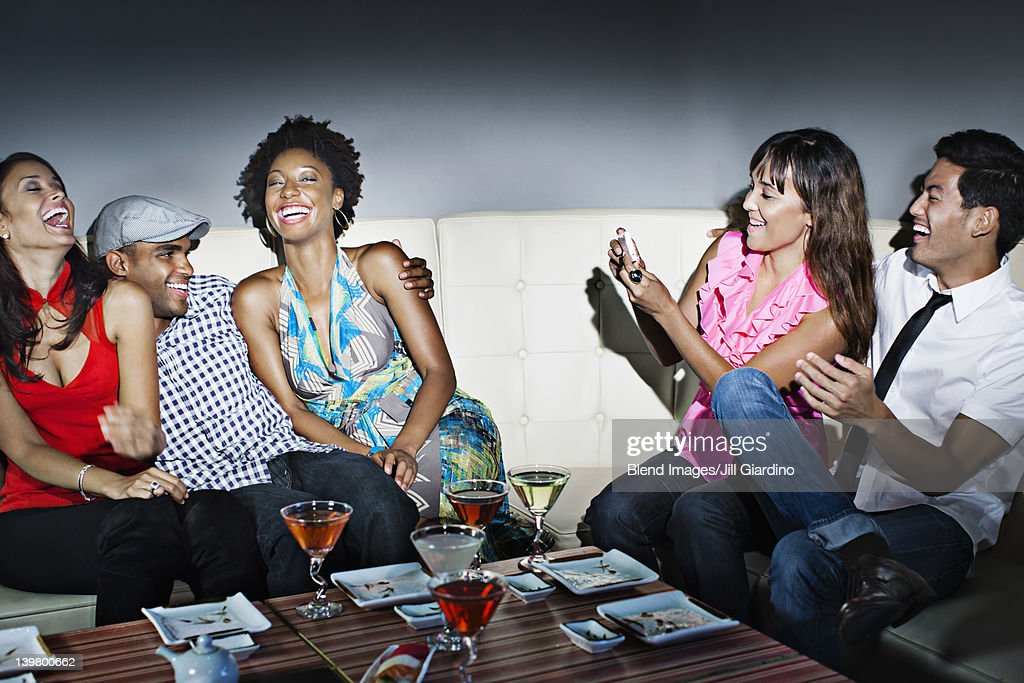 Friends drinking cocktails in nightclub : Stock Photo