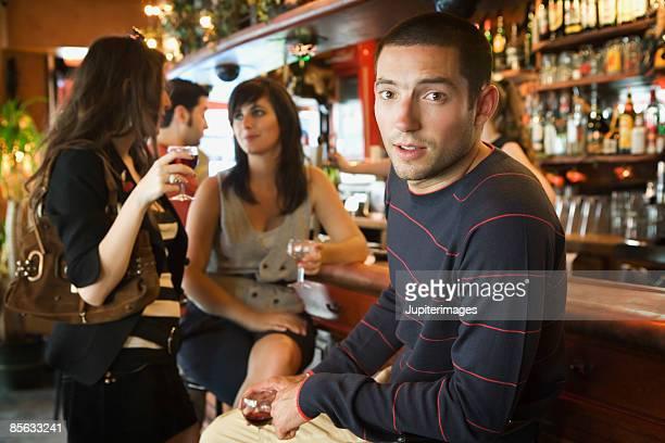 Friends drinking in bar