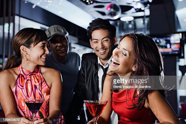 Friends drinking in nightclub