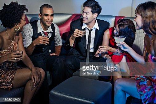 Friends drinking in nightclub : Stock Photo