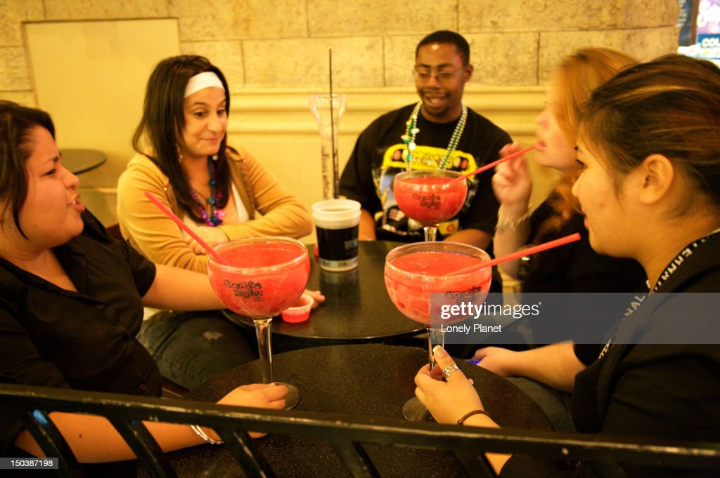 Friends drinking large cocktails. : Stock Photo