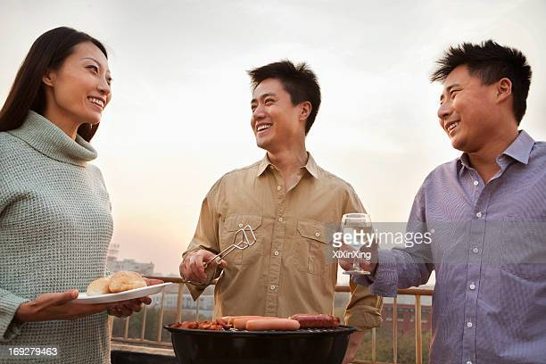 Friends Drinking Over a Barbecue