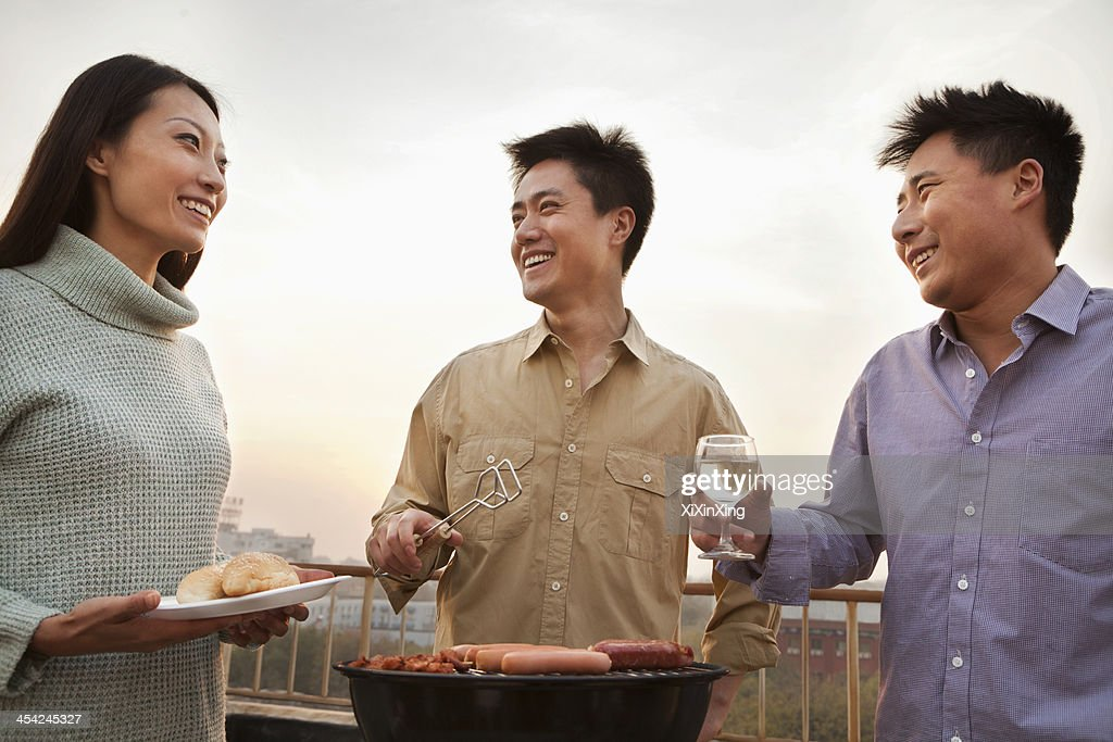 Friends Drinking Over a Barbecue : Stock Photo