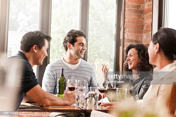 Friends drinking red wine in restaurant