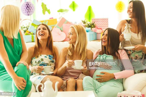 Friends drinking tea on baby shower party