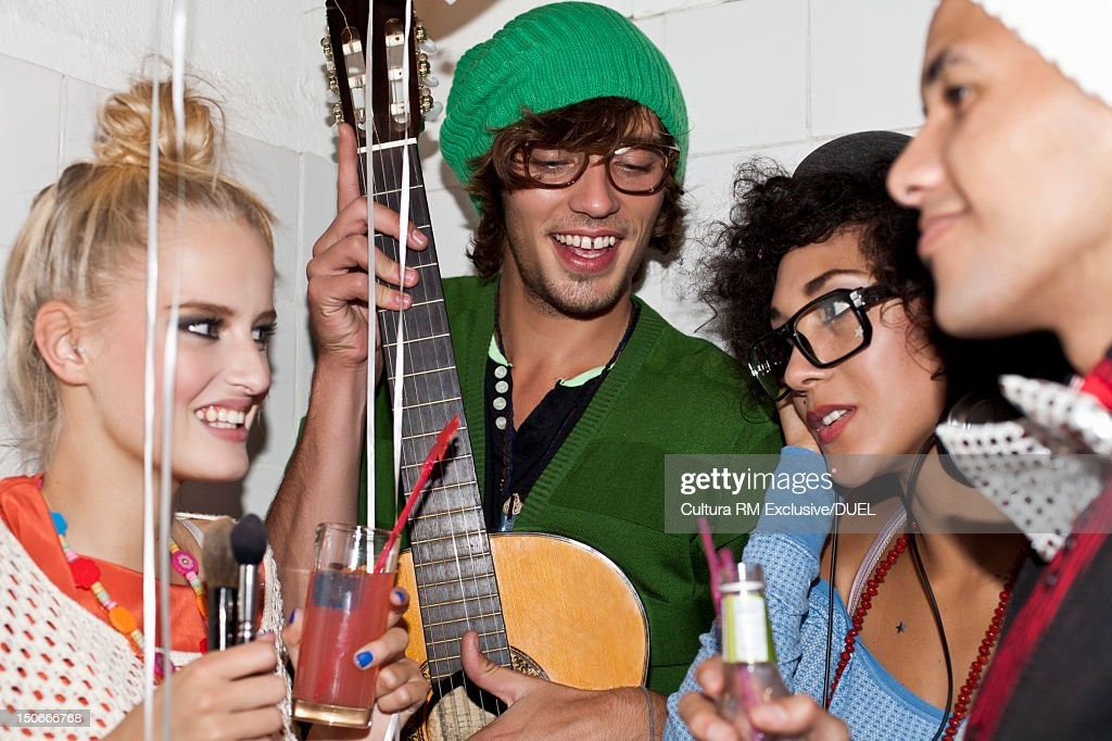 Friends drinking together at party : Stock Photo