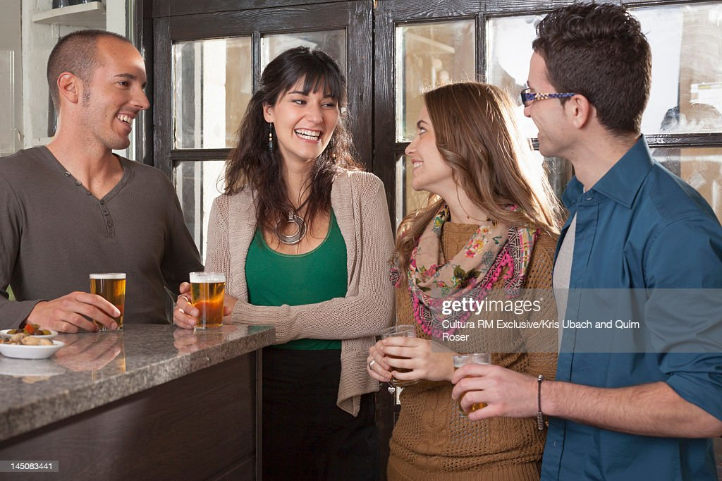 Friends drinking together in tapas bar : Stock Photo