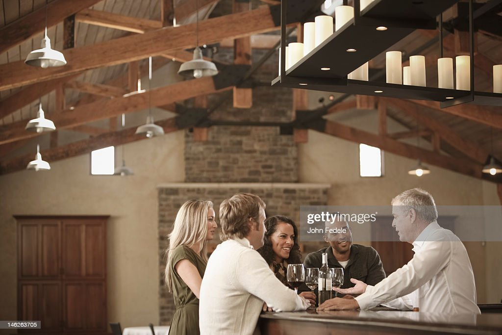 Friends drinking wine together : Stock Photo