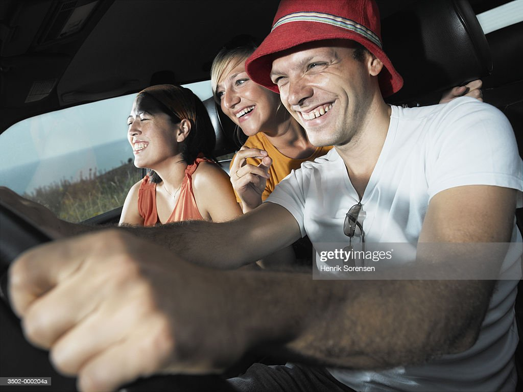 Friends Driving Automobile : Stock Photo