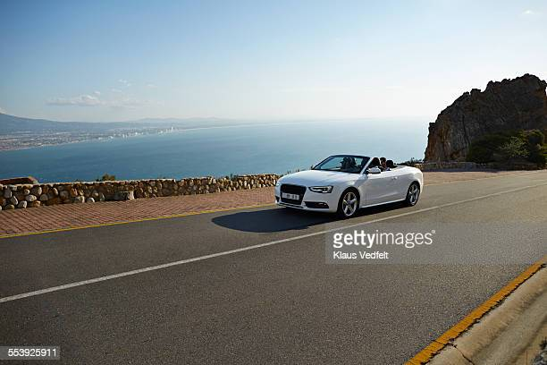 Friends driving in convertible car on mountainroad