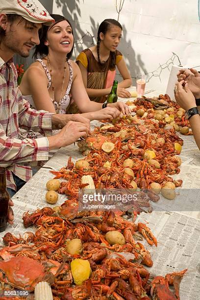 Friends eating at seafood boil