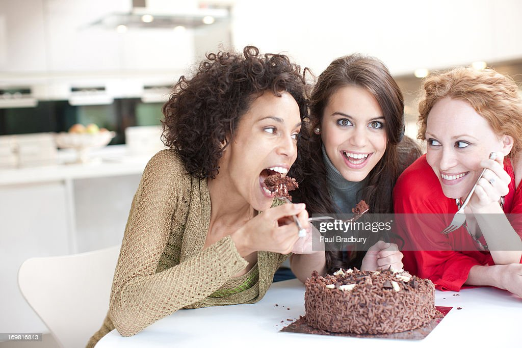 Friends eating chocolate cake : Stock Photo