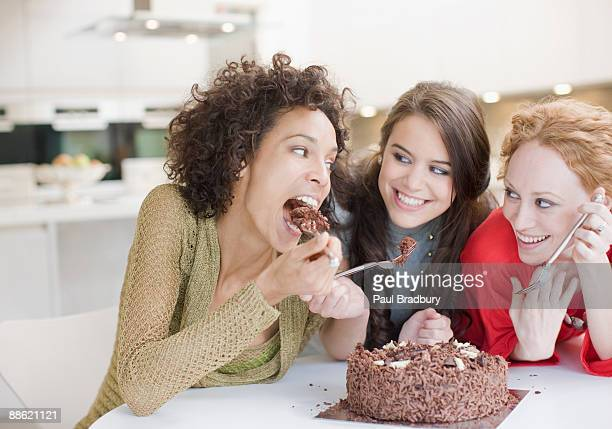 Friends eating chocolate cake