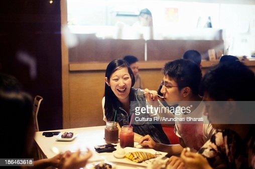 Friends eating dessert in cafe
