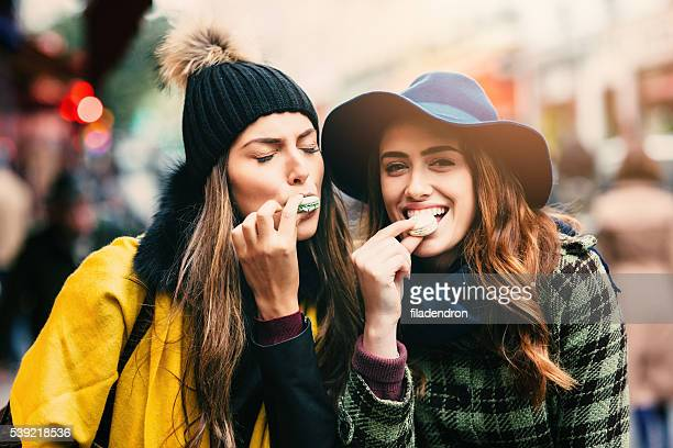 Friends eating macarons in Paris
