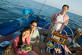Friends Eating Salad on Sailboat