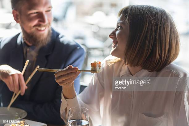 Friends eating sushi