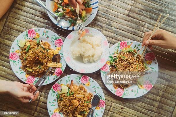 Friends eating Thai food