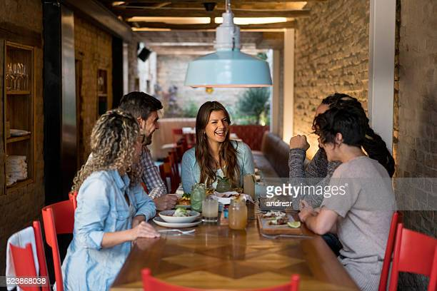 Friends eating together at a restaurant