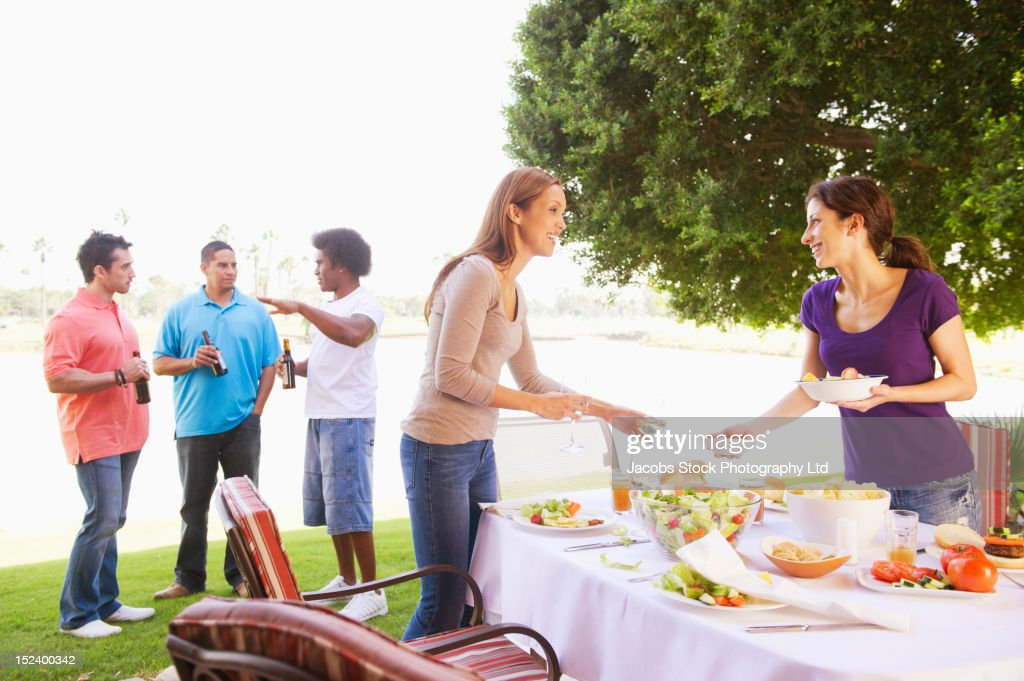 Friends eating together outdoors : Stock Photo