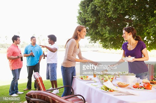 Friends eating together outdoors : Foto de stock