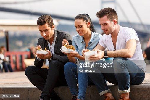 Friends eating turkish baked potato in Ortakoy, Istanbul