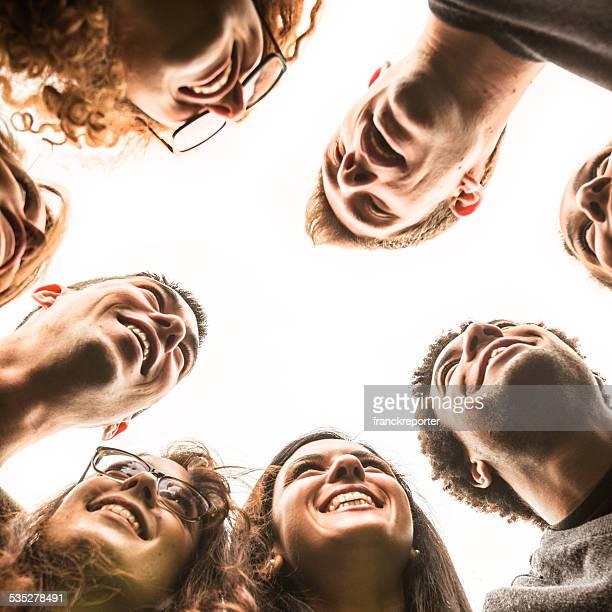 Friends embraced enjoy looking down