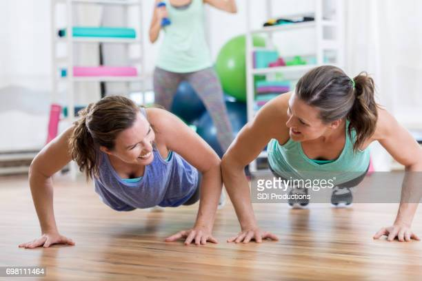 Friends encourage one another while working out