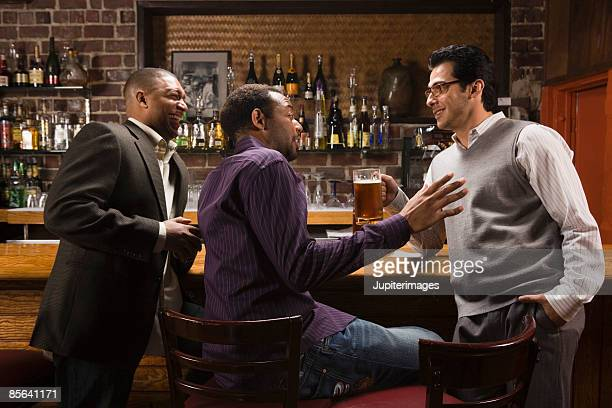 Friends engaged in conversation at bar