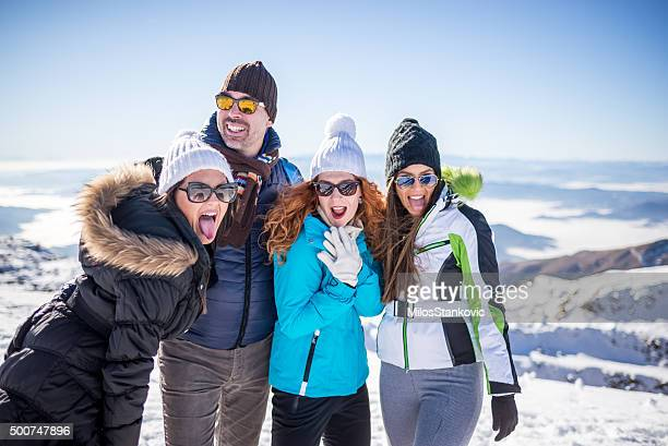 Friends enjoy at the top of mountain