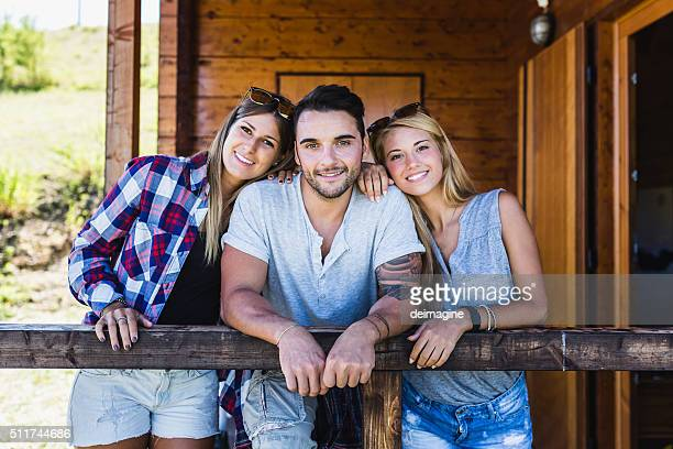 Friends enjoy their country cottage porch