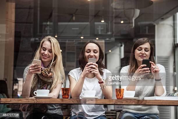 Friends enjoy together a cafe