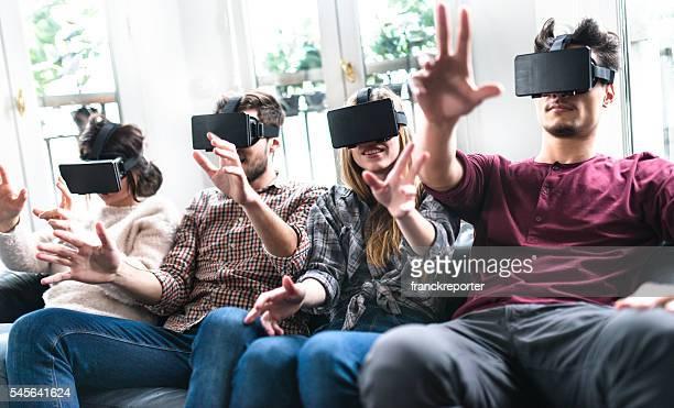 friends enjoy using the VR simulator togetherness