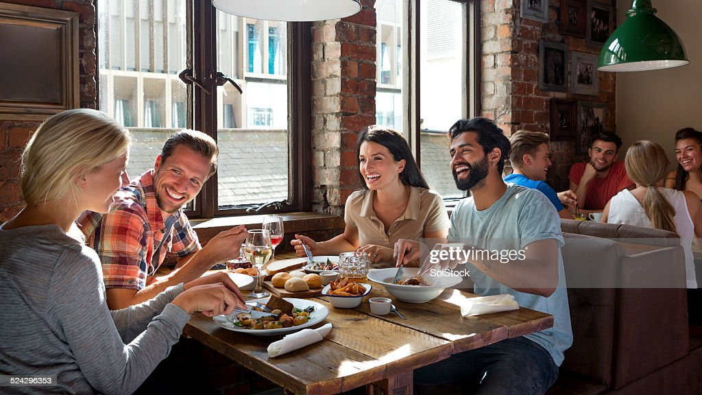 Friends Enjoying a Meal : Stock Photo
