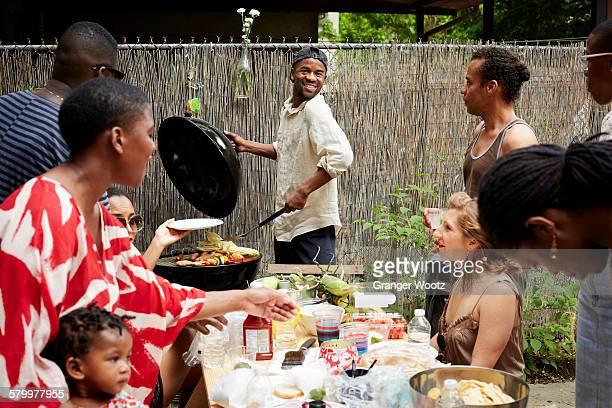Friends enjoying backyard barbecue