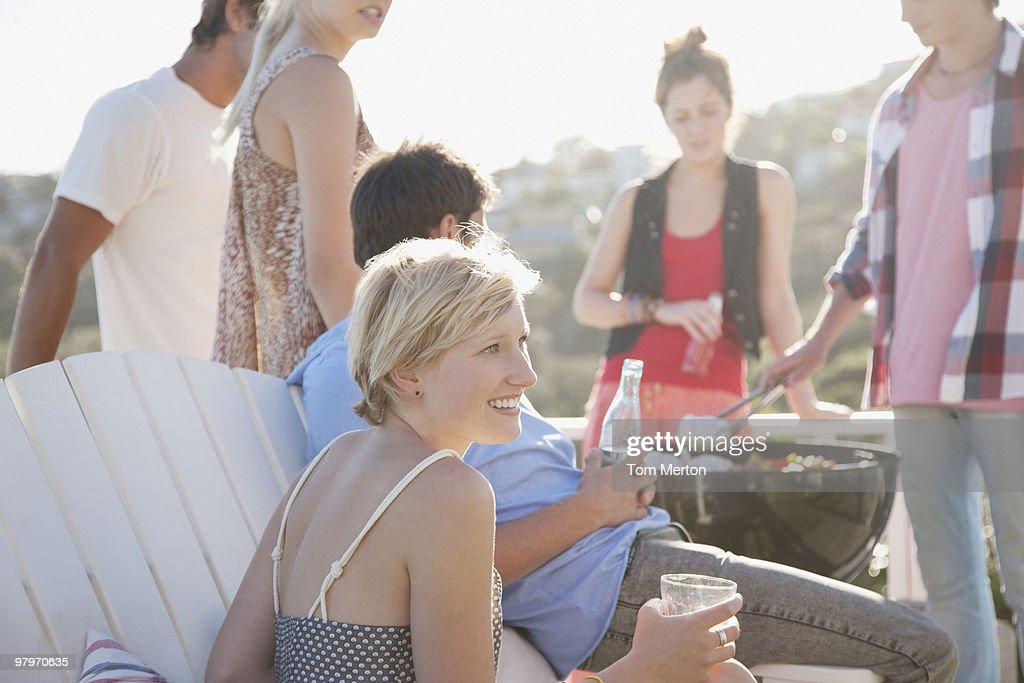 Friends enjoying barbecue : Stock Photo