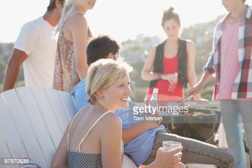 Friends enjoying barbecue : Stock Photo